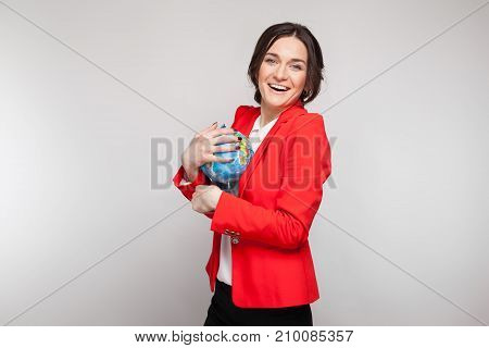 Picture Of Pretty Woman In Red Blazer With Earth Sphere In Hands