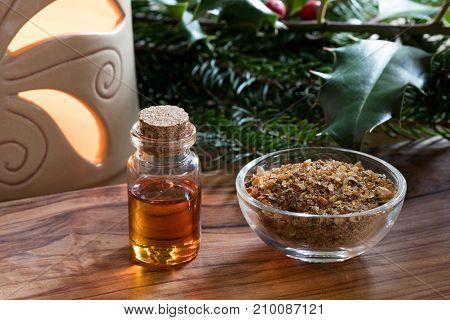 A Bottle Of Myrrh Essential Oil With Myrrh Resin In A Glass Bottle