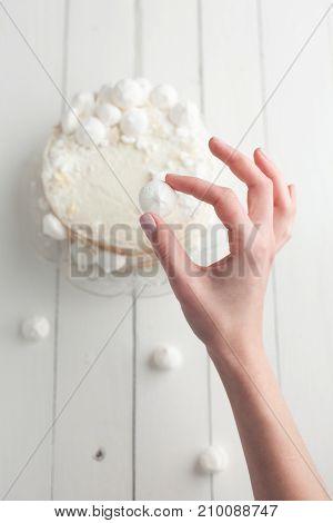 Girl Making Decoration For Cake