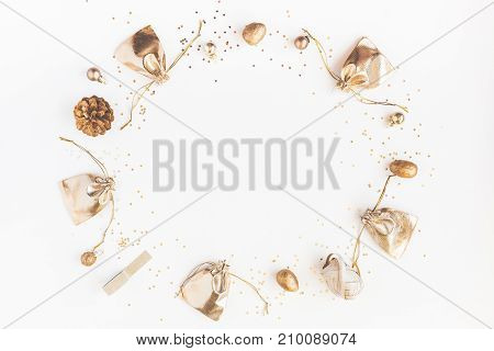 Christmas composition. Christmas gifts pine cones golden decorations on white background. Flat lay top view copy space