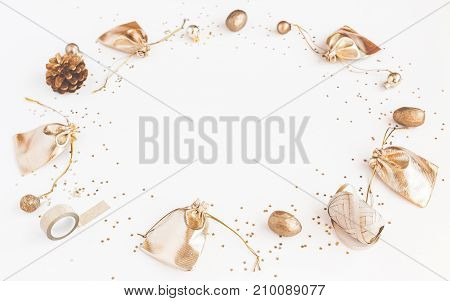Christmas composition. Christmas gifts pine cones golden decorations on white background