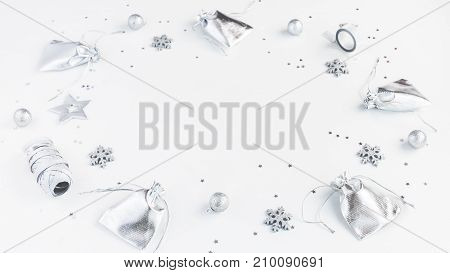 Christmas composition. Christmas gifts pine cones silver decorations on white background. Flat lay top view copy space