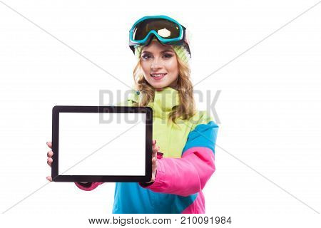 Young Woman In Ski Suit Hold Empty Tablet