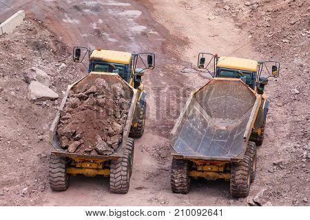 Construction Loading Rocks Trucks