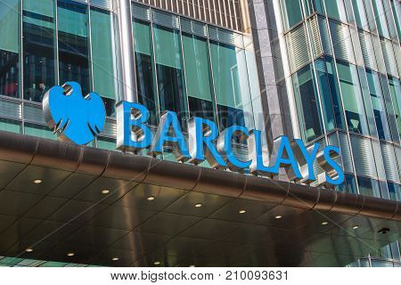 London, UK - March 15, 2017: Barclays bank sign above the main entrance to the bank building in Canary Wharf
