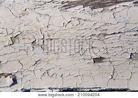 old white cracked paint on wood background