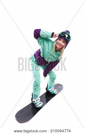 Young Pretty Woman In Purple Ski Costume Ride Snowboard