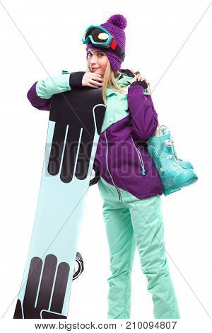 Young Beautiful Woman In Purple Ski Suit Hold Snow Boots And Snowboard