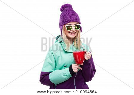 Beautiful Young Blonde Woman In Colorful Snow Costume Hold Red Cup