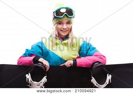 Pretty Young Blonde Woman In Colorful Snow Suit Sitting Cross-legged With Snowboard