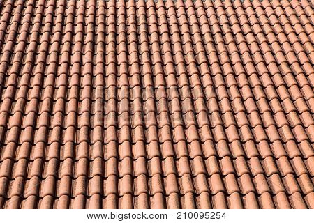 orange tile made of clay lying on the roof