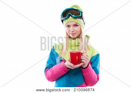 Pretty Young Woman In Ski Outfit And Ski Glasses Hold Red Cup