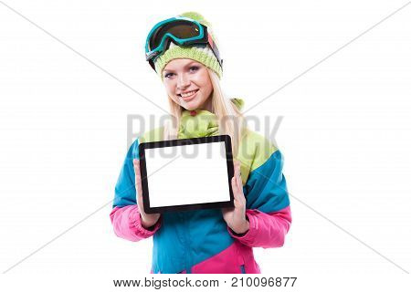Pretty Young Woman In Ski Outfit And Ski Glasses Hold Empty Tablet