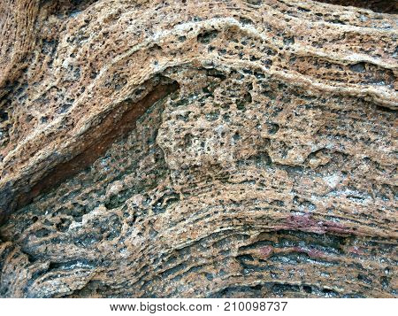 texture of lateral surfaces stone cliff protruding forward as a separate item