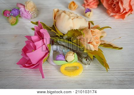 Flowers of FoamIran. Hair ornaments elastic bands on a wooden table. poster