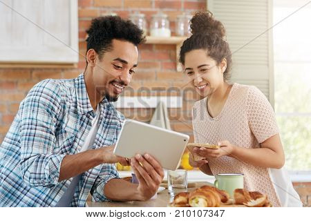 People, Family, Online Shopping Concept. Young Affectionate Couple Going To Buy New Accomodation, Lo