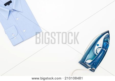 Blue Iron And Shirt On Ironing Board