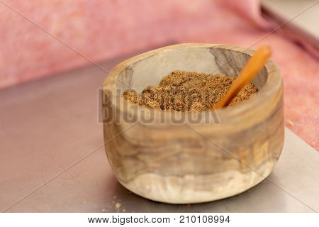 Molasses In A Wooden Bowl On A Light Background.