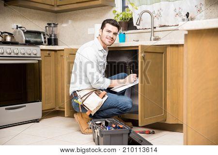 Writing Repair Estimate In A Kitchen