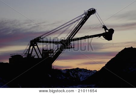 Heavy digger in open pit