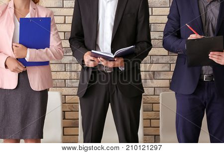 Group of people waiting for job interview, indoors