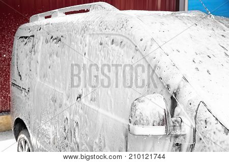 Automobile in suds at car wash