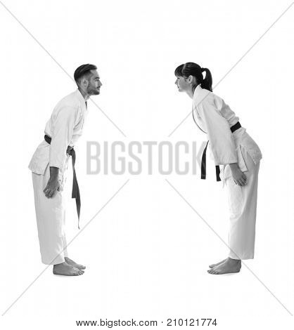 Young people practising karate on white background
