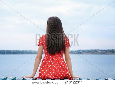 Young lady relaxing near river