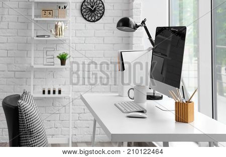 Comfortable workplace with modern computer on table