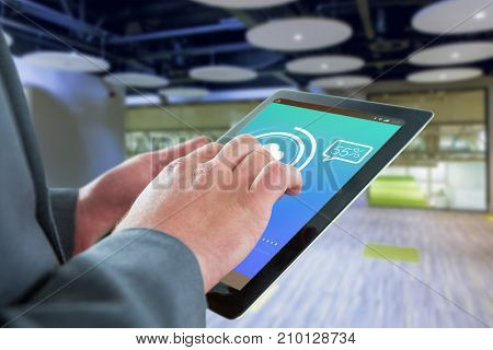 Businessman touching tablet screen against update text with download symbol