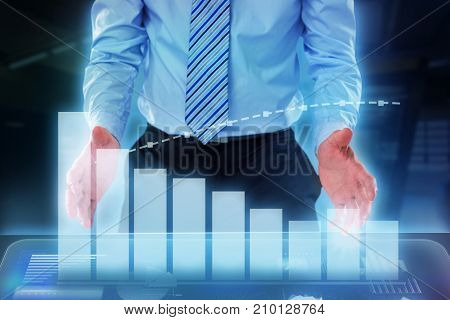 Midsection of businessman pretending to hold invisible object against a large room where is the meeting point