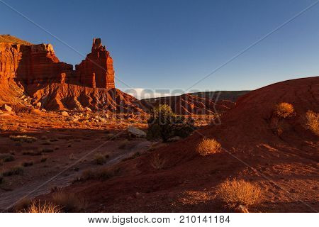 Moody red Chimney Rock and shadowy trail at Capitol Reef National Park in Utah.