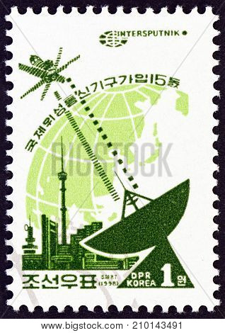 NORTH KOREA - CIRCA 1998: A stamp printed in North Korea issued for the 15th anniversary of North Korean Membership of Intersputnik shows Intersputnik, circa 1998.