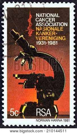 SOUTH AFRICA - CIRCA 1981: A stamp printed in South Africa issued for the 50th anniversary of National Cancer Association shows Microscope, circa 1981.