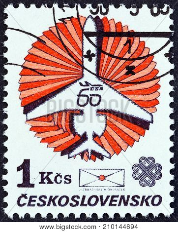 CZECHOSLOVAKIA - CIRCA 1983: A stamp printed in Czechoslovakia issued for the World Communications Year and 60th anniversary of Czechoslovak Airlines shows  Ilyushin Il-62 and envelope, circa 1983.