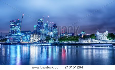 London, the United Kingdom: the Downtown andTower from the River Thames at night