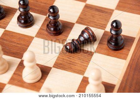 A Black Pawn Fell On A Chessboard