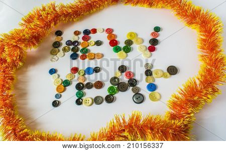 Many Different Buttons. Buttons For Clothes Made Of Plastic. View From Above. The Buttons Write A Ne