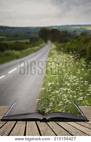 Landscape Image Of Empty Road In English Countryside With Dramatic Stormy Sky Overhead Concept Comin