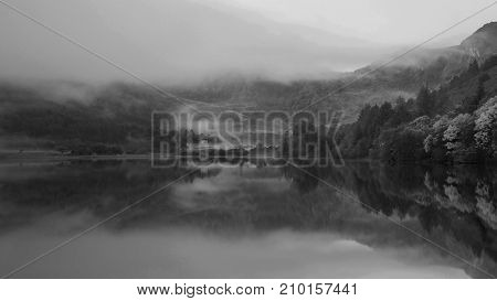 Black And White Landscape Of Llyn Crafnant During Foggy Autumn Morning In Snowdonia National Park