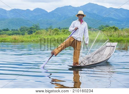 INLE LAKE MYANMAR - SEP 07 : Burmese fisherman at Inle lake Myanmar on September 07 2017 inle Lake is a freshwater lake located in Shan state