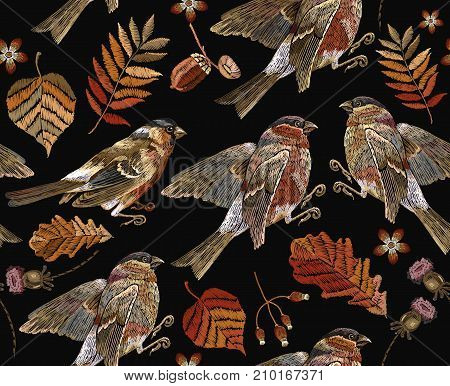 Embroidery autumn and birds seamless pattern. Fashionable template for design of clothes t-shirt design. Classical september embroidery autumn leaves bullfinch and titmouse.