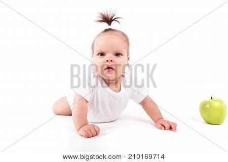 Cute Cheerful Little Girl In White Shirt Near Apple