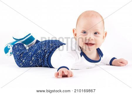 Happy Cute Little Boy In White Shirt And Trousers