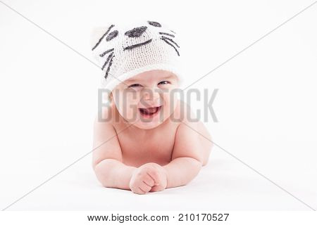 Cute Happy Baby Boy In Diaper And White Cat Hat
