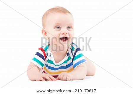 Cute Amazed Little Boy In Colorful Shirt Lies On Belly