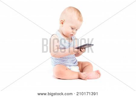 Cute Pretty Baby Boy In Blue Shirt And Diaper Hold Cellphone