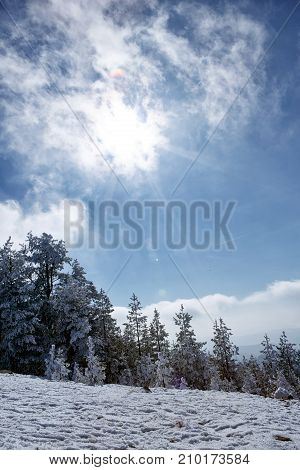 Beautiful snowy sunshine winter landscape in the mountains on sunny day