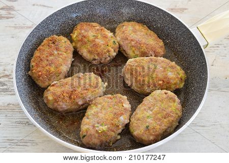 Meatballs with zucchini coated in bread crumbs. Healthy eating concept. Step by step cooking.