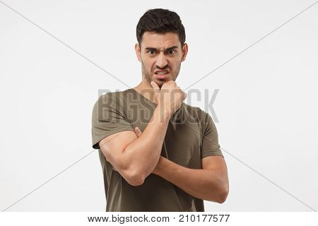 Disguting! Shocked Young Man Looking At Something Unpleasant And Bad, Isolated On Gray Background. N